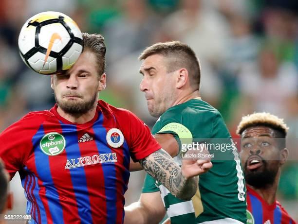 Vit Benes of Vasas FC wins the ball from Daniel Bode of Ferencvarosi TC in front of Manjrekar James of Vasas FC during the Hungarian OTP Bank Liga...