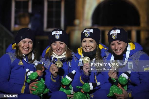 Vita Semerenko Anastasiya Merkushyna Yuliia Dzhima and Valj Semerenko of Ukraine celebrate winning the Bronze medal at the Medal Ceremony for the IBU...