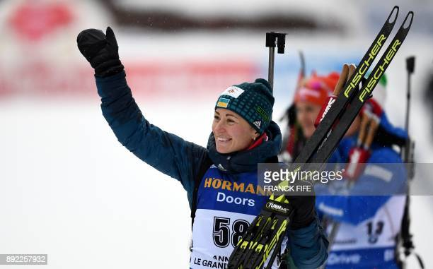 Vita Semerenko of Ukraine celebrates on the podium after taking third place at the event women's 75 km sprint event at the IBU World Cup Biathlon in...