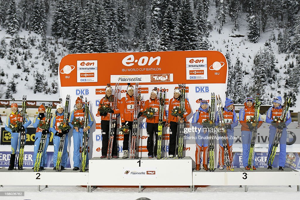 Vita Semerenko, Valj Semerenko, Dzhyma Juliya, Olena Pidhrushna of Ukraine take 2nd, Fanny Welle-Strand Horn, Synnoeve Solemda, Fenne Hilde, Tora Berger of Norway take 1st place, Glazyrina Ekaterina, Olga Zaitseva, Shumilova Ekaterina, Olga Vilukhina of Russia take 3rd place during the IBU Biathlon World Cup WomenÕs Relay on December 09, 2012 in Hochfilzen, Austria.