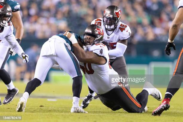 Vita Vea of the Tampa Bay Buccaneers tackles Miles Sanders of the Philadelphia Eagles at Lincoln Financial Field on October 14, 2021 in Philadelphia,...
