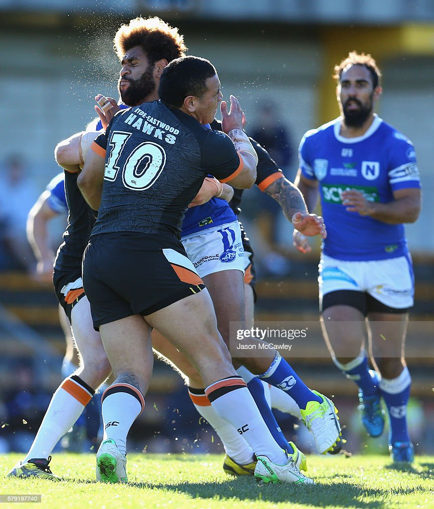 Vitale Roqica of the Newtown Jets is tackled by Wesley Lolo of the Wests Tigers during the round 19 Intrust Super Premiership NSW match between the Wests Tigers and the Newtown Jets at Leichhardt Oval on July 23, 2016 in Sydney, Australia.