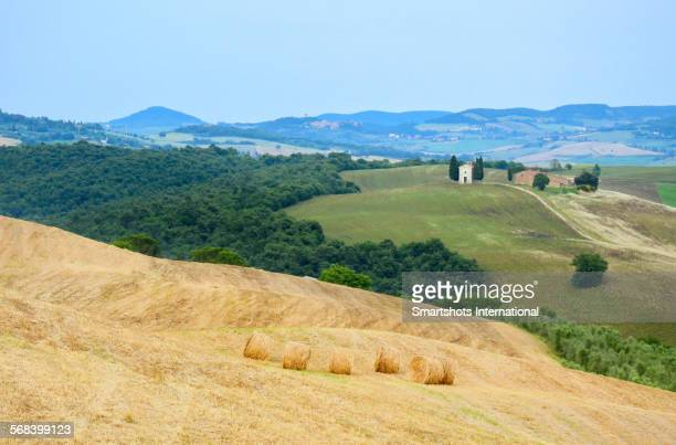 vitaleta chapel with haystacks in summer, italy - san quirico d'orcia stock pictures, royalty-free photos & images
