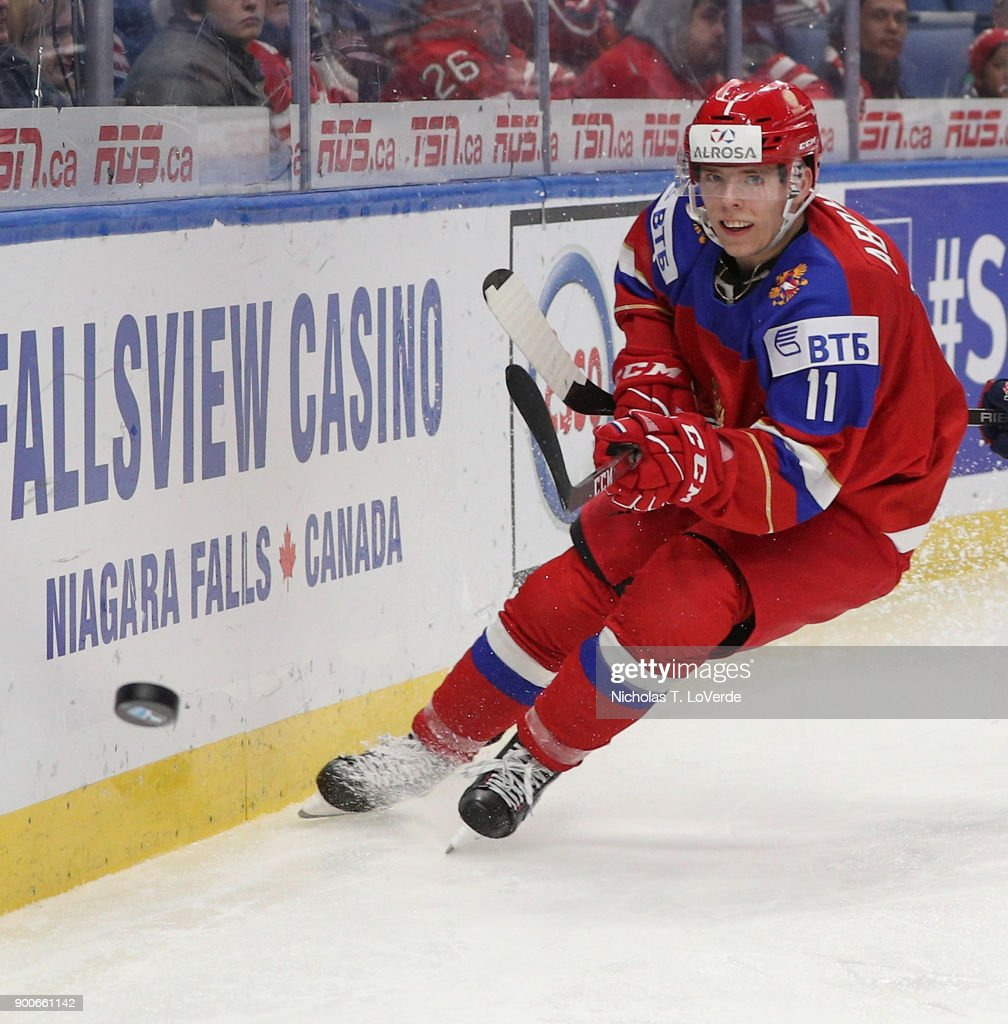 Vitali Abramov #11 of Russia shoots the puck around the boards against the United States during the third period of play in the Quarterfinal IIHF World Junior Championship game at the KeyBank Center on January 2, 2018 in Buffalo, New York.