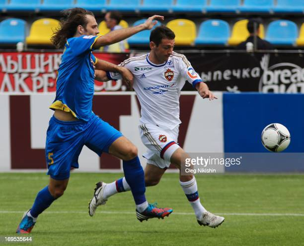 Vitali Dyakov of FC Rostov competes for the ball with Alan Dzagoev of CSKA Moscow during the Russian Premier League match betweenn CSKA Moscow and FC...