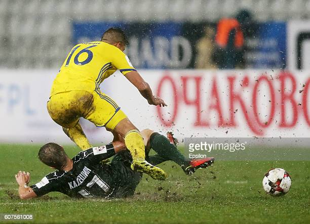 Vitali Kaleshin of FC Krasnodar is challenged by Christian Noboa of FC Rostov during the Russian Premier League match between FC Krasnodar v FC...