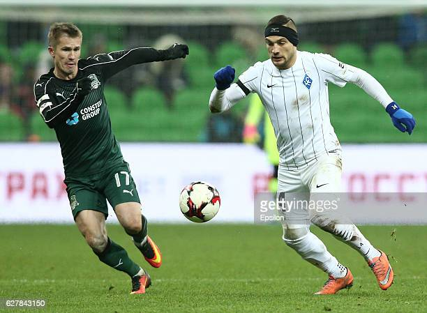 Vitali Kaleshin of FC Krasnodar is challenged by Yohan Mollo of FC Krylia Sovetov Samara during the Russian Premier League match between FC Krasnodar...