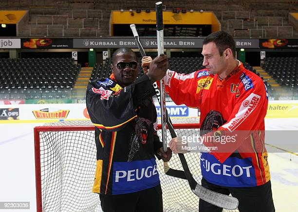 Vitali Klitschko and Kevin Johnson pose for the media on the ice of the Post Finance Arena after a news conference October 23, 2009 in Bern,...