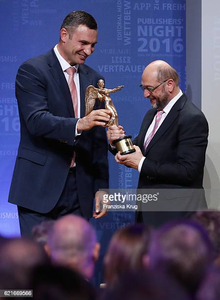 Vitali Klitschko awards the prize for 'European of the year' to European Parliament President Martin Schulz during the VDZ Publishers' Night 2016 at...