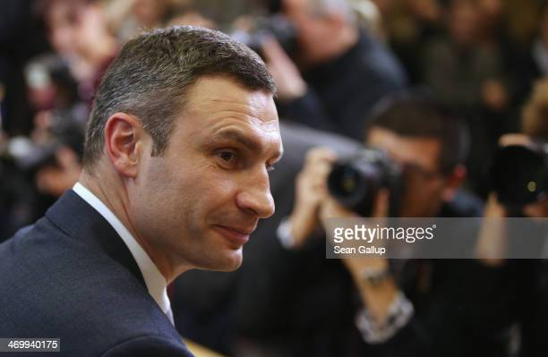Vitali Klitschko Chairman of the UDAR Ukrainian opposition party arrives to speak at a press conference along with Ukrainian opposition politician...