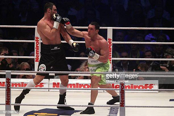 Vitali Klitschko fends a punch thrown by Albert Sosnowski of Poland during the WBC Heavyweight World Championship fight between Vitali Klitschko of...