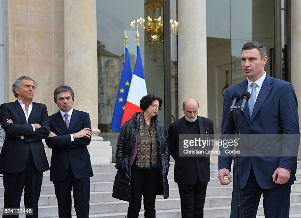 Vitali Klitschko Francois Hollande Petro Poroshenko and Bernard Henri Levy French President Francois Hollande welcomes the head of the Ukrainian UDAR...