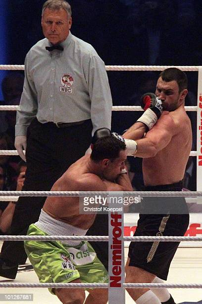 Vitali Klitschko gets a punch of Albert Sosnowski of Poland during the WBC Heavyweight World Championship fight between Vitali Klitschko of Ukraine...