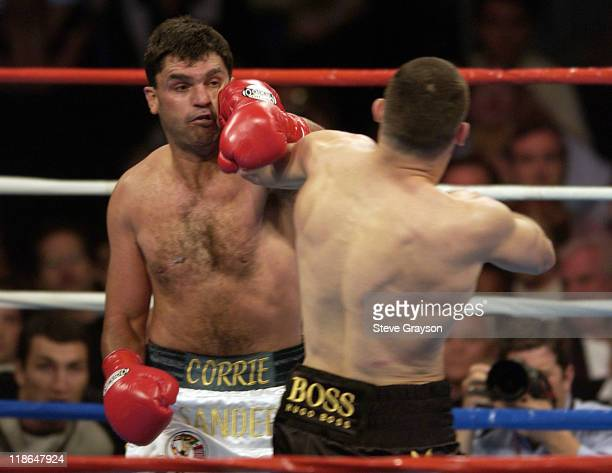 Vitali Klitschko lands a punch on Corrie Sanders during the eighth round of their 12-round WBC heavyweight championship bout in Los Angeles,...