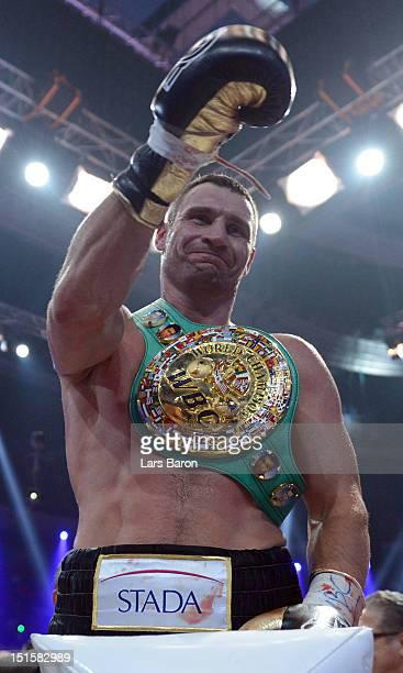 Vitali Klitschko of the Ukraine celebrates after winning the WBCheavy weight title fight between Vitali Klitschko of Ukraine and Manuel Charr of...