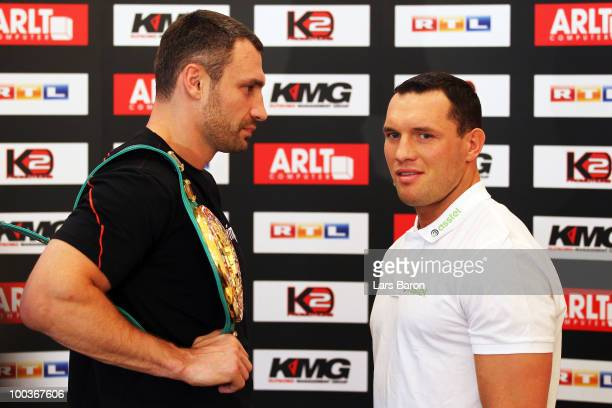 Vitali Klitschko of Ukraine and Albert Sosnowski of Poland pose during a press conference at Stadtgarten Steele on May 24 2010 in Essen Germany The...