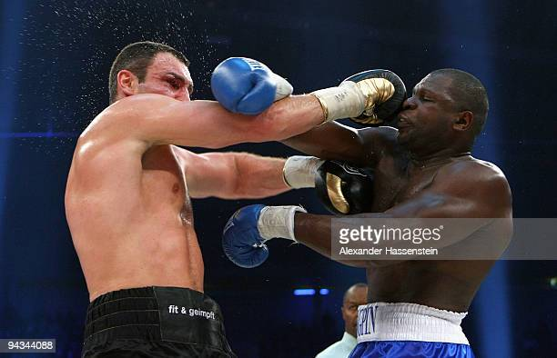 Vitali Klitschko of Ukraine and Kevin Johnson of USA exchange punches during their WBC World Championship Heavyweight fight at the Postfinance-Arena...