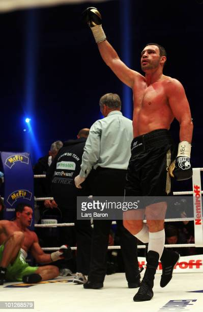 Vitali Klitschko of Ukraine celebrates infront of Albert Sosnowski after winning the WBC Heavyweight World Championship fight against Albert...