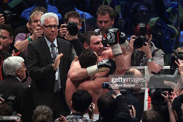Vitali Klitschko of Ukraine embraces Albert Sosnowski of Poland afterr winning in the tenth round the WBC Heavyweight World Championship fight...