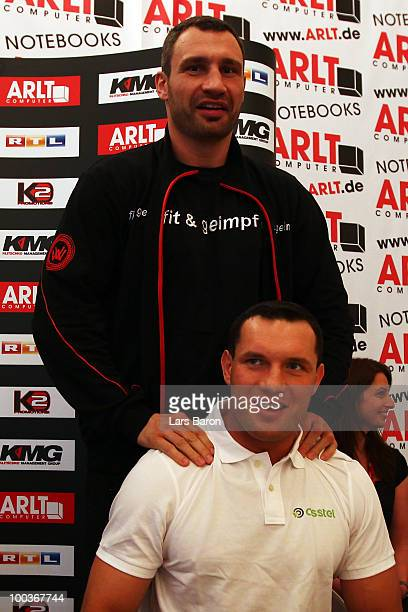 Vitali Klitschko of Ukraine gives Albert Sosnowski of Poland a massage during a press conference at Stadtgarten Steele on May 24 2010 in Essen...