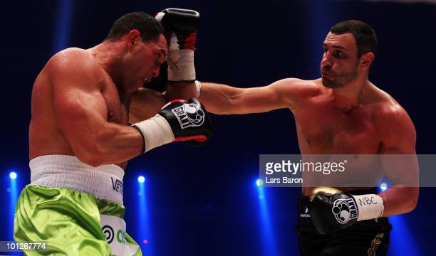 Vitali Klitschko of Ukraine hits Albert Sosnowski of Poland during the WBC Heavyweight World Championship fight between Vitali Klitschko of Ukraine...