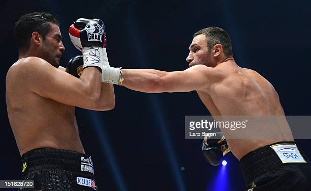 Vitali Klitschko of Ukraine punshes Manuel Charr of Germany during the WBCheavy weight title fight between Vitali Klitschko of Ukraine and Manuel...