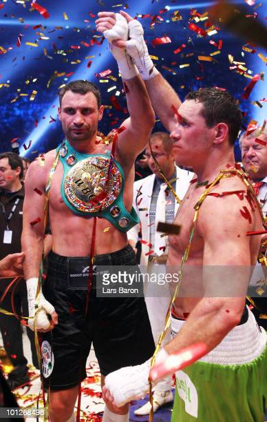 Vitali Klitschko of Ukraine shakes hands with Albert Sosnowski of Poland after winning the WBC Heavyweight World Championship fight against Albert...