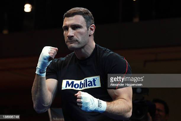 Vitali Klitschko of Ukraine warms up for a public training session at Mercedes Benz show room on February 15 2012 in Munich Germany Vitali Klitschko...