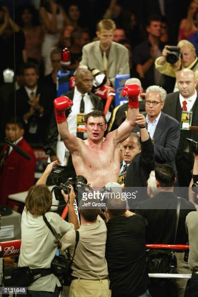 Vitali Klitschko raises his hands in the air to the crowd after the WBC and IBO World Heavyweight Championship bout against Lennox Lewis at the...