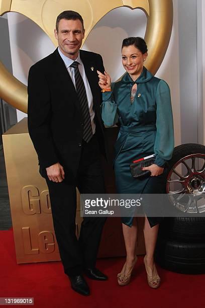 """Vitali Kltschko and Lina van de Mars attend """"Das Goldene Lenkrad 2011"""" Awards at Axel-Springer Haus on November 9, 2011 in Berlin, Germany."""