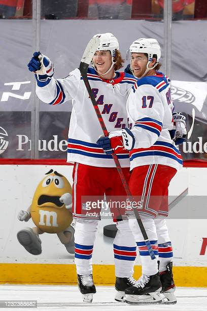 Vitali Kravtsov of the New York Rangers is congratulated by his teammate Kevin Rooney after scoring his first career NHL goal against the New Jersey...