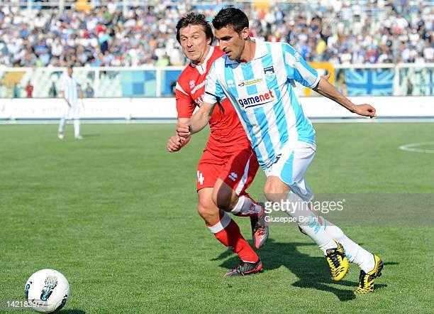 Vitali Kutuzov of Bari and Antonio Bocchetti of Pescara in action during the Serie B match between Pescara Calcio and AS Bari at Adriatico Stadium on...
