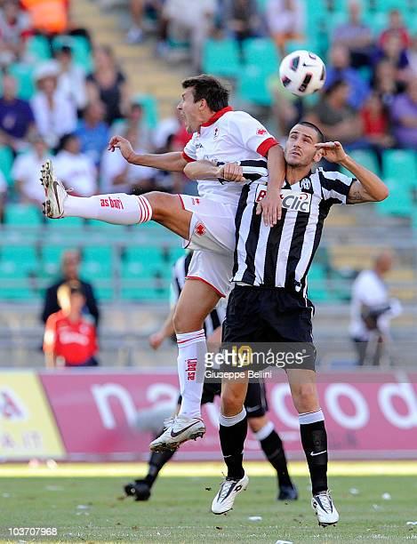 Vitali Kutuzov of Bari and Leonardo Bonucci of Juventus in action during the Serie A match between Bari and Juventus at Stadio San Nicola on August...