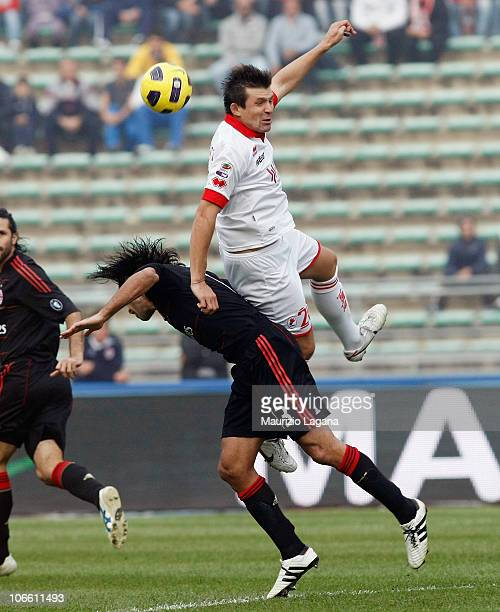 Vitali Kutuzov of Bari competes for the ball with Alessandro Nesta of Milan during the Serie A match between Bari and Milan at Stadio San Nicola on...