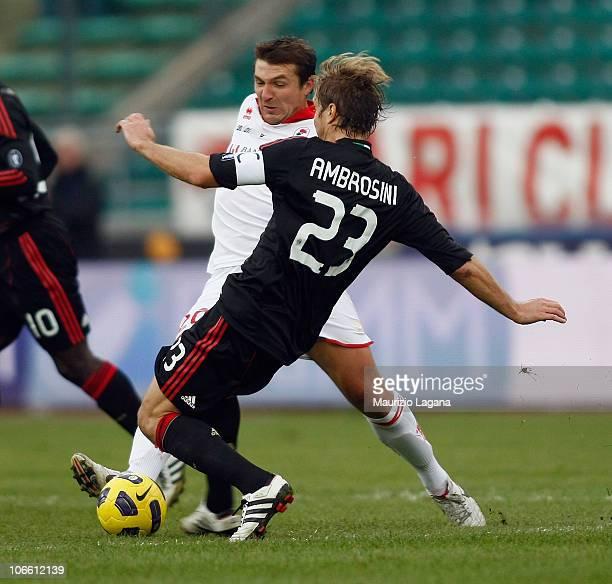 Vitali Kutuzov of Bari competes for the ball with Massimo Ambrosini of Milan during the Serie A match between Bari and Milan at Stadio San Nicola on...