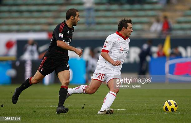 Vitali Kutuzov of Bari competes for the ball with Mathieu Flamini of Milan during the Serie A match between Bari and Milan at Stadio San Nicola on...