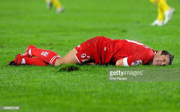 Vitali Kutuzov of Bari lies on the turf injured during the Serie A match between AC Chievo and AS Bari at Stadio Marc'Antonio Bentegodi on November...