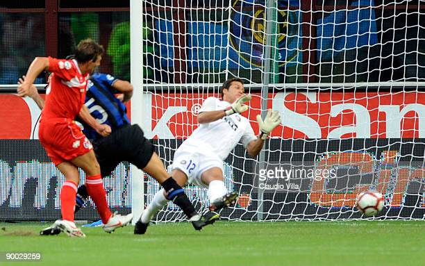 Vitali Kutuzov of Bari scores the 1:1 equaliser past Inter Milan's goalkeeper Julio Cesar during the Serie A match between Inter Milan and Bari at...