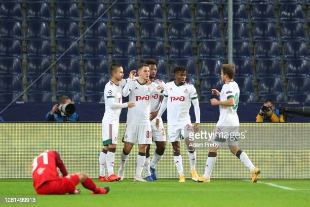 Vitali Lisakovich of Lokomotiv Moskva celebrates with teammates after scoring his sides second goal during the UEFA Champions League Group A stage...