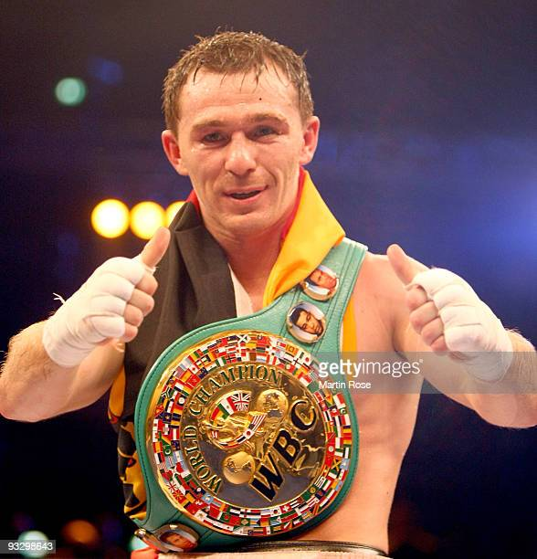 Vitali Tajbert of Germany celebrates after the WBC interim super featherweight world championship fight during the Universum Champions night boxing...