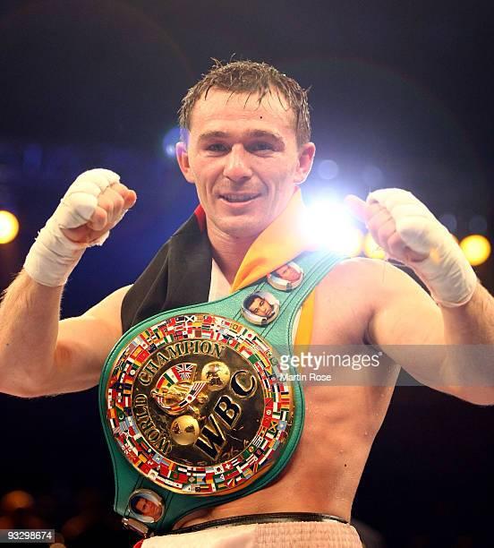 Vitali Tajbert of Germany celebrates after the WBC interim super featherweight world championship fight during the Universum Champions night boxing...