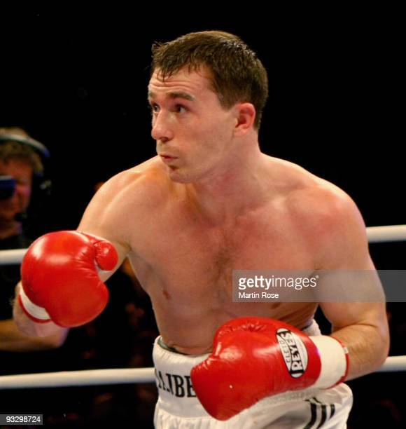 Vitali Tajbert of Germany exchanges in action during the WBC interim super featherweight world championship fight during the Universum Champions...