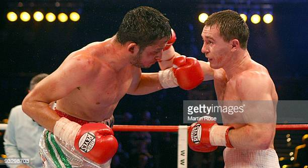 Vitali Tajbert of Germany exchanges punches with Humberto Mauro Gutierrez of Mexico during the WBC interim super featherweight world championship...