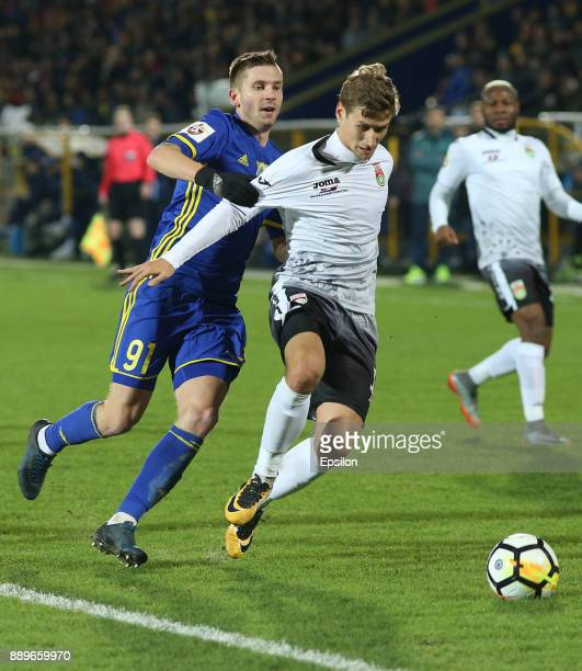 Vitali Ustinov of FC Rostov RostovonDon vies for the ball with Dmitri Zhivoglyadov of FC Ufa during the Russian Premier League match between FC...