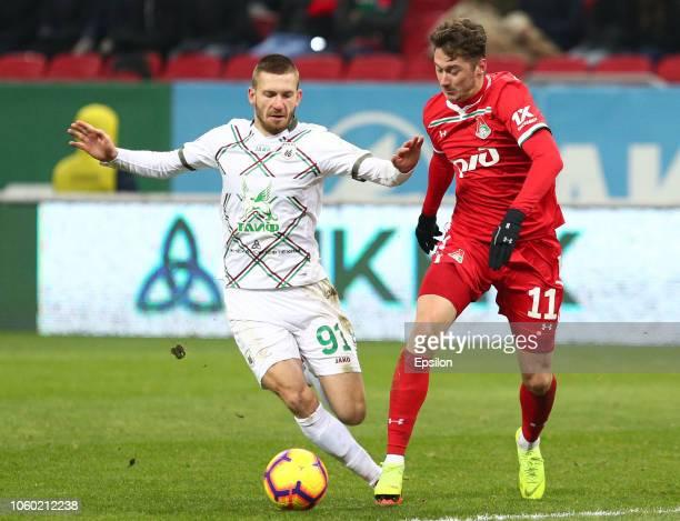 Vitali Ustinov of FC Rubin Kazan vies for the ball with Anton Miranchuk FC Lokomotiv Moscow during the Russian Premier League match between FC Rubin...
