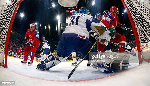 Vitali Yeremeyev, goalkeeper of Kazakhstan saves the shot of Viktor Kozlov of Russia during the IIHF World Championship group A match between Russia...