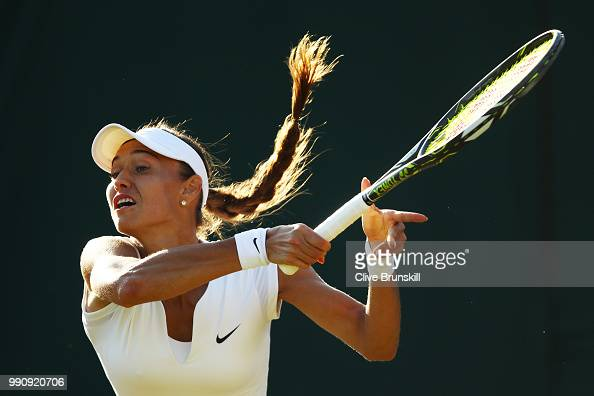 Vitalia Diatchenko of Russia returns against Maria Sharapova of Russia during their Ladies' Singles first round match on day two of the Wimbledon...