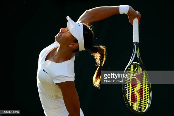 Vitalia Diatchenko of Russia serves against Maria Sharapova of Russia during their Ladies' Singles first round match on day two of the Wimbledon Lawn...