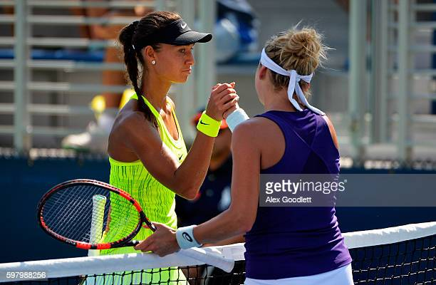 Vitalia Diatchenko of Russia shakes hands with Timea Bacsinszky of Switzerland after their first round Women's Singles match on Day Two of the 2016...
