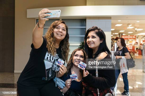 Vitalia Mendoza Yovanka Mendoza Griselda Loza pose with their vote stickers after casting their ballots during the midterm elections at the Galleria...